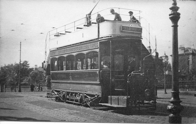 Open top 'white car' at Shields Road crossing c.1920 (no route numbers at this time.)  Photographer unknown; from a contemporary postcard.