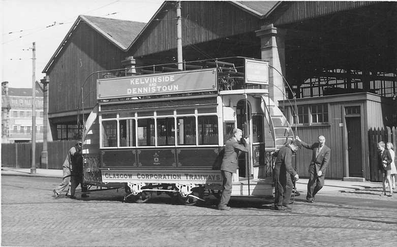 Car 543 is man-handled out of the Coplawhill Works (Tramway). Date as above.