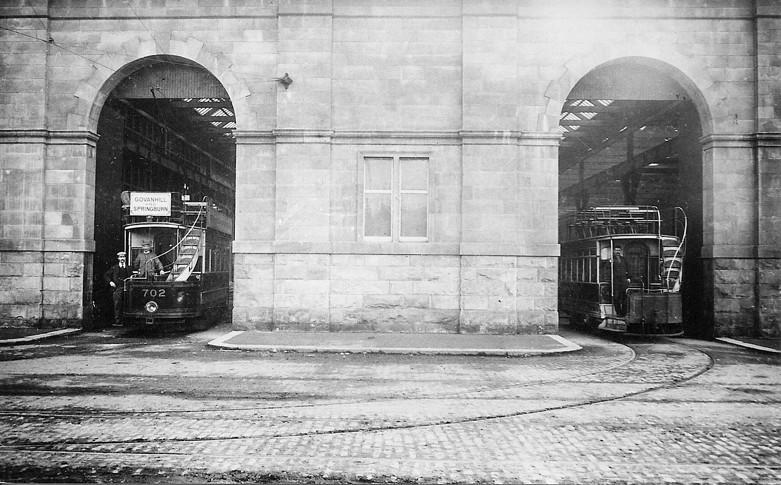 Two open-top cars at the Works. Probably pre-First World War.  Photographer unknown, but possibly the Corporation itself.
