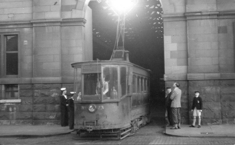 Permanent Way maintenance Car 23 leaves the Works. 24 June 1960. (Hamish Stevenson appears on the right.) The sailors are a mystery!