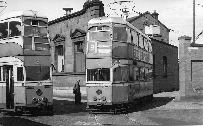 Two redundant 'Coronation' Cars, 1398 and 1195, being moved into the Barrland Street yards in September 1962.  The red sandstone building behind, now Walker Woodstock premises, housed the Corporation Transport uniforms store.