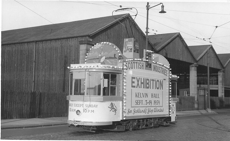 Another decorated car, a disguised PWD 27, outside the Works on 5 September 1959, advertises an exhibition at the Kelvin Hall.